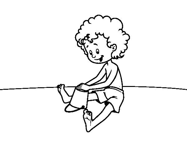 Coloriage de Enfant jouant dans le sable pour Colorier